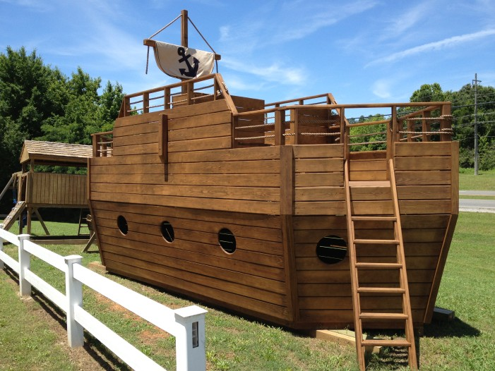 Large Playship playset with slide and swings